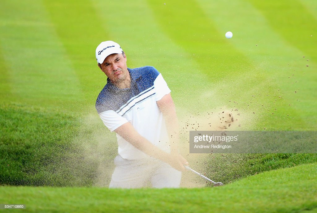 <a gi-track='captionPersonalityLinkClicked' href=/galleries/search?phrase=Simon+Khan&family=editorial&specificpeople=215124 ng-click='$event.stopPropagation()'>Simon Khan</a> of England plays out of a bunker on the 18th hole during day two of the BMW PGA Championship at Wentworth on May 27, 2016 in Virginia Water, England.
