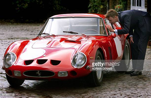 Simon Kidston of Bonham and Brooks auction house peers inside a vintage 1963 Ferrari 250 GTO which won the 1963 Le Mans GT race in London 30 October...
