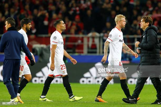 Simon Kjaer Gabriel Mercado and Ever Banega of Sevilla are seen dejected after the goal of Spartak Moscow during the UEFA Champions League match...