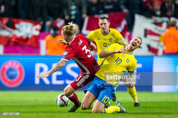 Simon Kjaer of Denmark and Zlatan Ibrahimovic of Sweden collide during the European Qualifier PlayOff between Sweden and Denmark on November 14 2015...