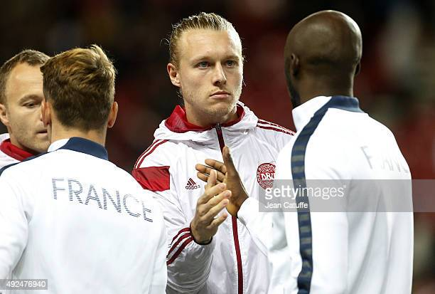 Simon Kjaer of Denmark shakes hands with Eliaquim Mangala of France prior to the international friendly match between Denmark and France at Telia...