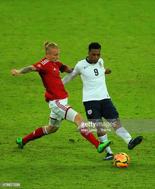 Simon Kjaer of Denmark tackles Daniel Sturridge of England during the International Friendly match between England and Denmark at Wembley Stadium on...