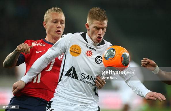 Simon Kjaer of Lille and Gaetan Charbonnier of Reims in action during the french Ligue 1 match between LOSC Lille and Stade de Reims at the Grand...