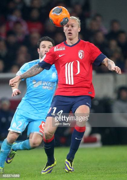 Simon Kjaer of Lille and Mathieu Valbuena of OM in action during the French Ligue 1 match between Lille OSC and Olympique de Marseille OM at the...