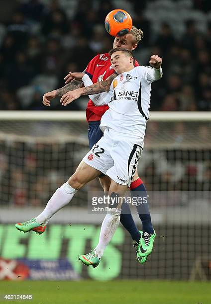 Simon Kjaer of Lille and Nicolas De Preville of Reims in action during the french Ligue 1 match between LOSC Lille and Stade de Reims at the Grand...