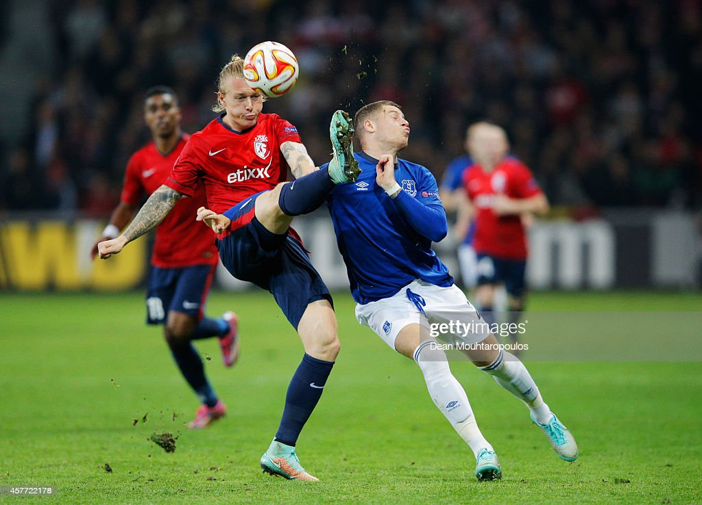 Simon Kjaer of Lille clears the ball from Ross Barkley of Everton during the UEFA Europa League Group H match between LOSC Lille and Everton at Grand...