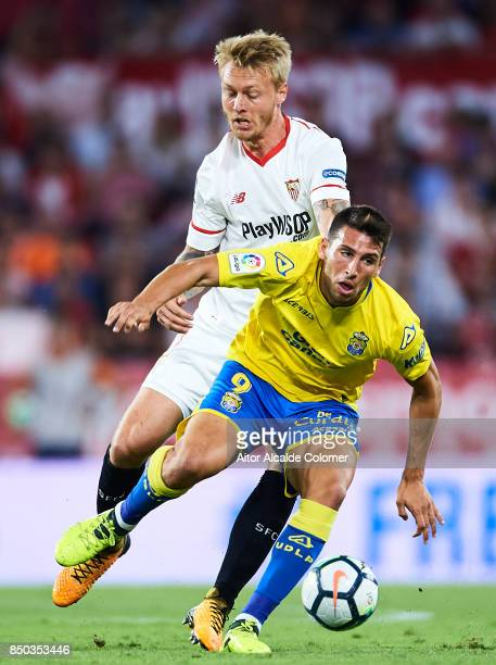 Simon Kjaer of Sevilla FC competes for the ball with Jonathan Calleri of Union Deportiva Las Palmas during the La Liga match between Sevilla and Las...