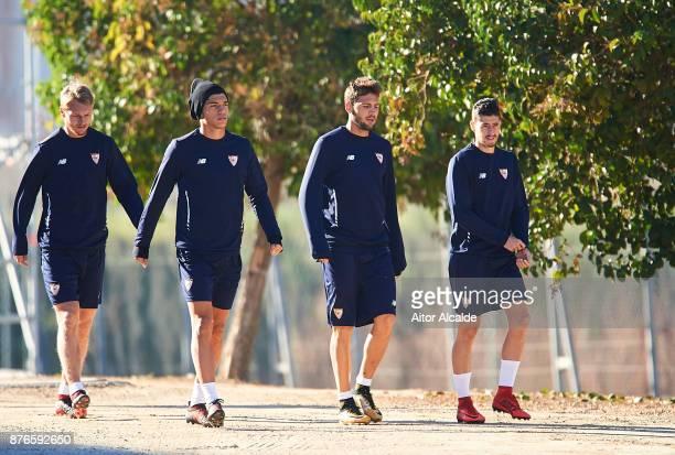 Simon Kjaer of Sevilla FC Joaquin Correa of Sevilla FC Franco Vazquez of Sevilla FC and Sergio Escudero of Sevilla FC looks on during the training of...