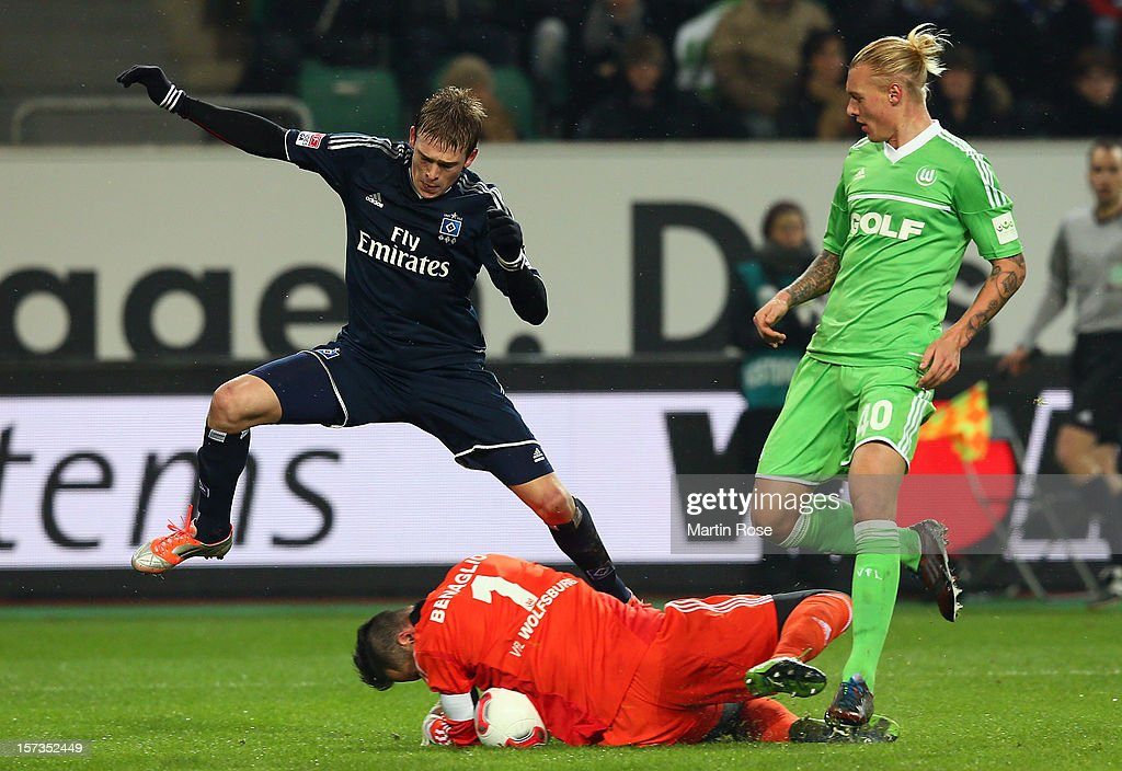 Simon Kjaer (L) of Wolfsburg and Artjoms Rudnevs (R) of Hamburg battle for the ball during the Bundesliga match between VfL Wolfsburg and Hamburger SV at Volkswagen Arena on December 2, 2012 in Wolfsburg, Germany.