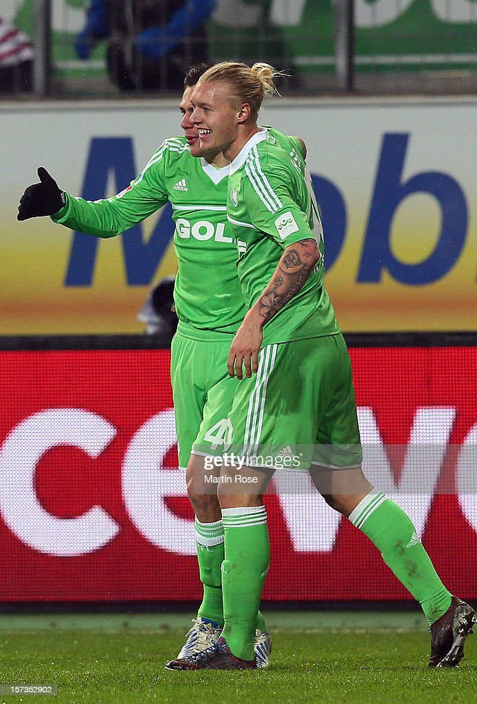 <a gi-track='captionPersonalityLinkClicked' href=/galleries/search?phrase=Simon+Kjaer&family=editorial&specificpeople=4895333 ng-click='$event.stopPropagation()'>Simon Kjaer</a> (R) of Wolfsburg celebrates after he scores his team's equalizing goal during the Bundesliga match between VfL Wolfsburg and Hamburger SV at Volkswagen Arena on December 2, 2012 in Wolfsburg, Germany.