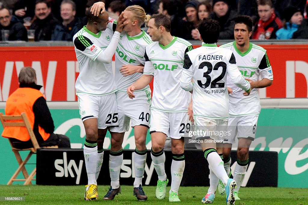 <a gi-track='captionPersonalityLinkClicked' href=/galleries/search?phrase=Simon+Kjaer&family=editorial&specificpeople=4895333 ng-click='$event.stopPropagation()'>Simon Kjaer</a> (2nd L) of Wolfsburg celebrates his goal with team mates during the Bundesliga match between Bayer 04 Leverkusen and VfL Wolfsburg at BayArena on April 6, 2013 in Leverkusen, Germany.