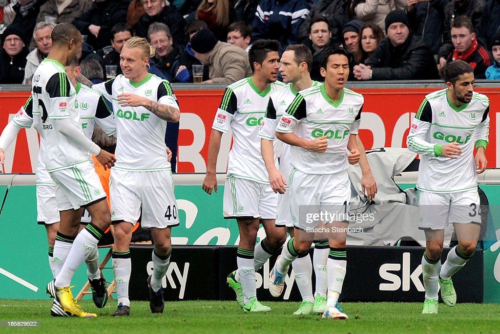 Simon Kjaer (2nd L) of Wolfsburg celebrates his goal with team mates during the Bundesliga match between Bayer 04 Leverkusen and VfL Wolfsburg at BayArena on April 6, 2013 in Leverkusen, Germany.