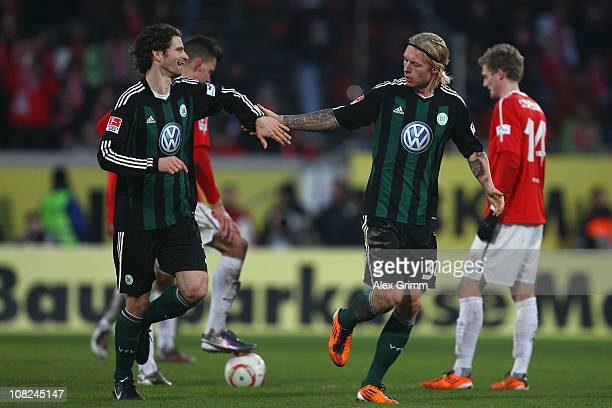 Simon Kjaer of Wolfsburg celebrates his team's first goal with team mate Arne Friedrich during the Bundesliga match between FSV Mainz 05 and VfL...