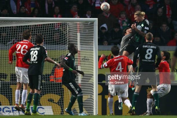 Simon Kjaer of Wolfsburg scores his team's first goal against goalkeeper Heinz Mueller of Mainz during the Bundesliga match between FSV Mainz 05 and...