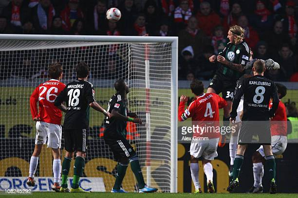 Simon Kjaer of Wolfsburg scores his team's first goal during the Bundesliga match between FSV Mainz 05 and VfL Wolfsburg at Bruchweg Stadium on...