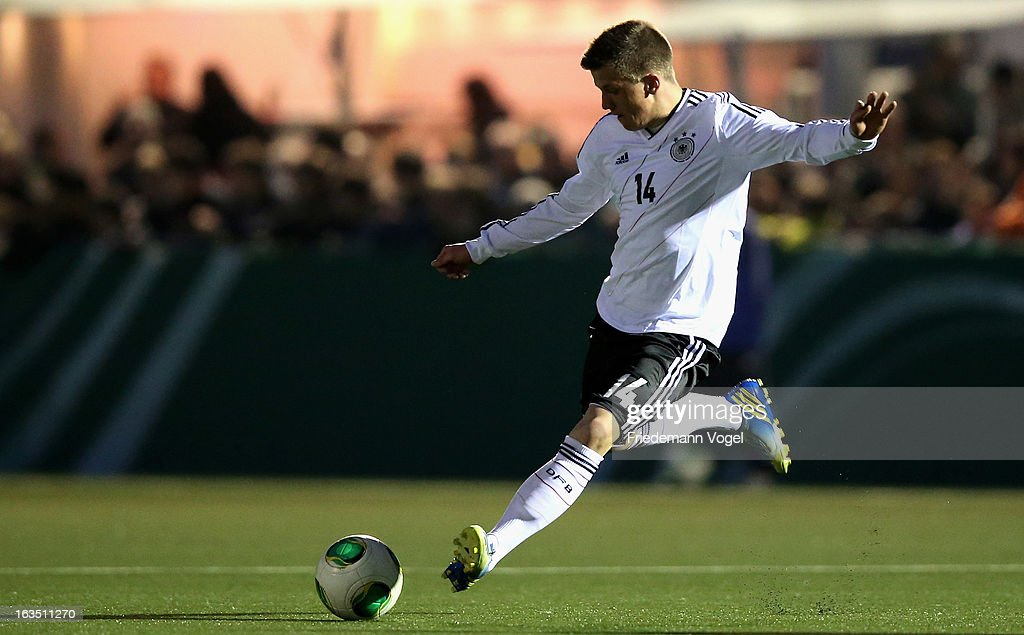 Simon Kranitz of Germany runs with the ball during the U17 International Friendly match between Germany and Georgia at Toennies-Arena on March 6, 2013 in Rheda-Wiedenbruck, Germany.