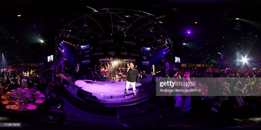 Simon Le Bon and Duran Duran perform at amfAR's 20th Annual Cinema Against AIDS during The 66th Annual Cannes Film Festival at Hotel du Cap-Eden-Roc on May 23, 2013 in Cap d'Antibes, France.