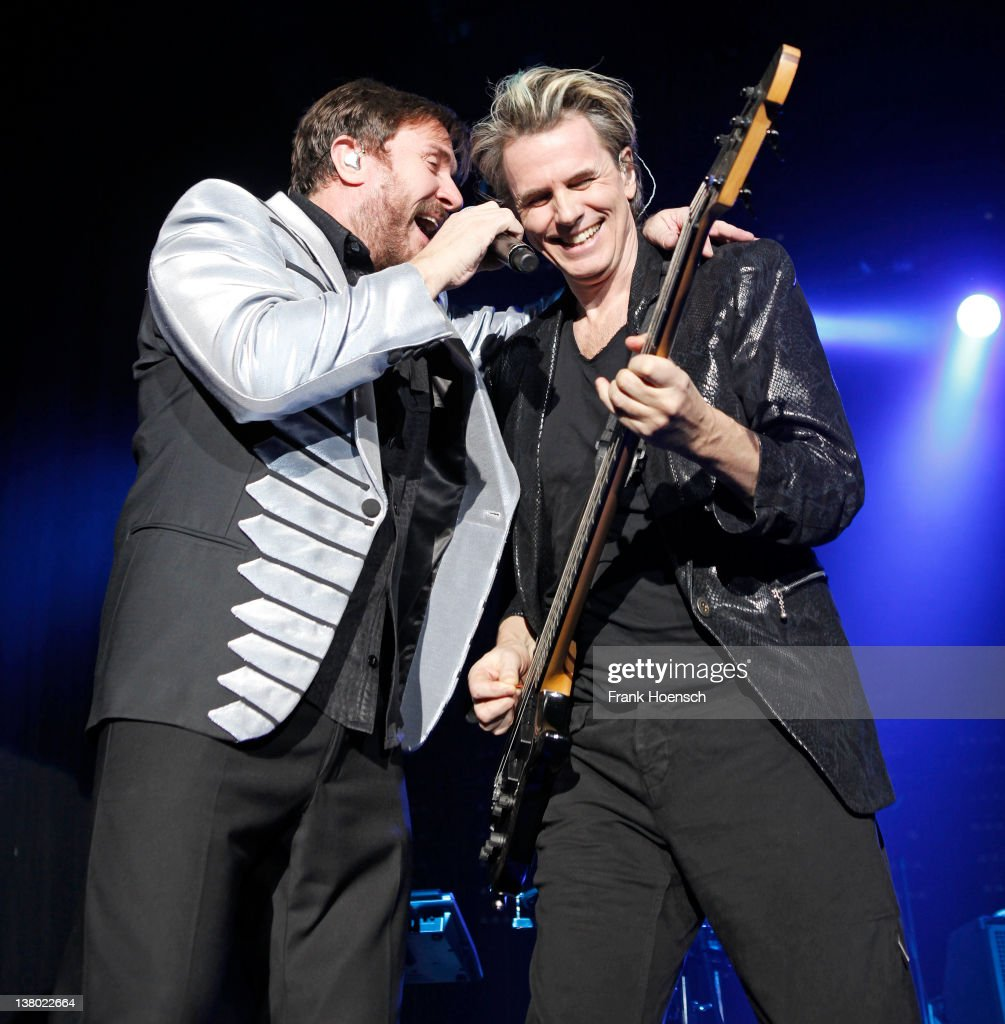 Simon Le Bon and John Taylor of the band Duran Duran perform live during a concert at the Columbiahalle on January 31, 2012 in Berlin, Germany.