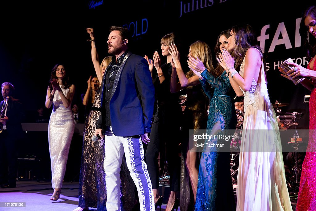 Simon Le Bon and models perform onstage during the show for amfAR's 20th Annual Cinema Against AIDS at Hotel du Cap-Eden-Roc on May 23, 2013 in Cap d'Antibes, France.