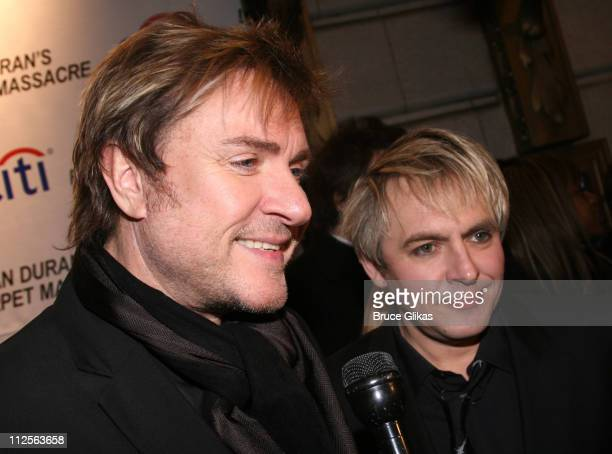 Simon Le Bon and Nick Rhodes of Duran Duran pose at Duran Duran's 'Red Carpet Massacre' Opening Night on Broadway at Ethel Barrymore Theater on...