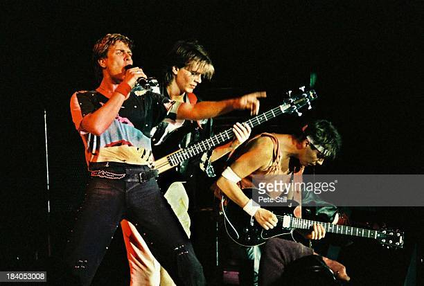 Simon Le Bon John Taylor and Andy Taylor of Duran Duran perform on stage at Wembley Arena on December 20th 1983 in London England