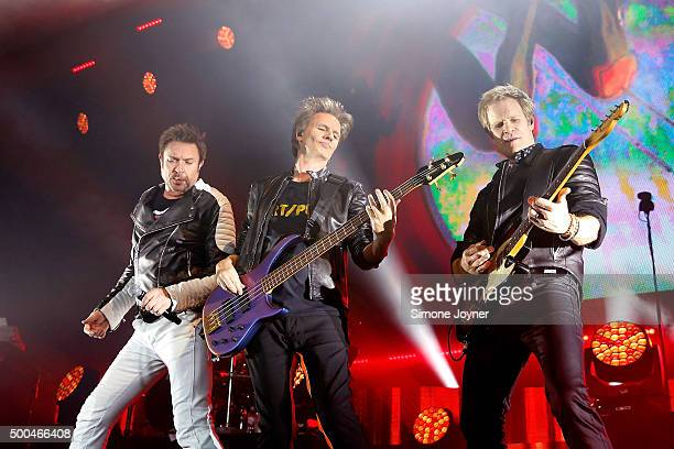 Simon Le Bon John Taylor and Dom Brown of Duran Duran perform live on stage at The O2 Arena on December 8 2015 in London England