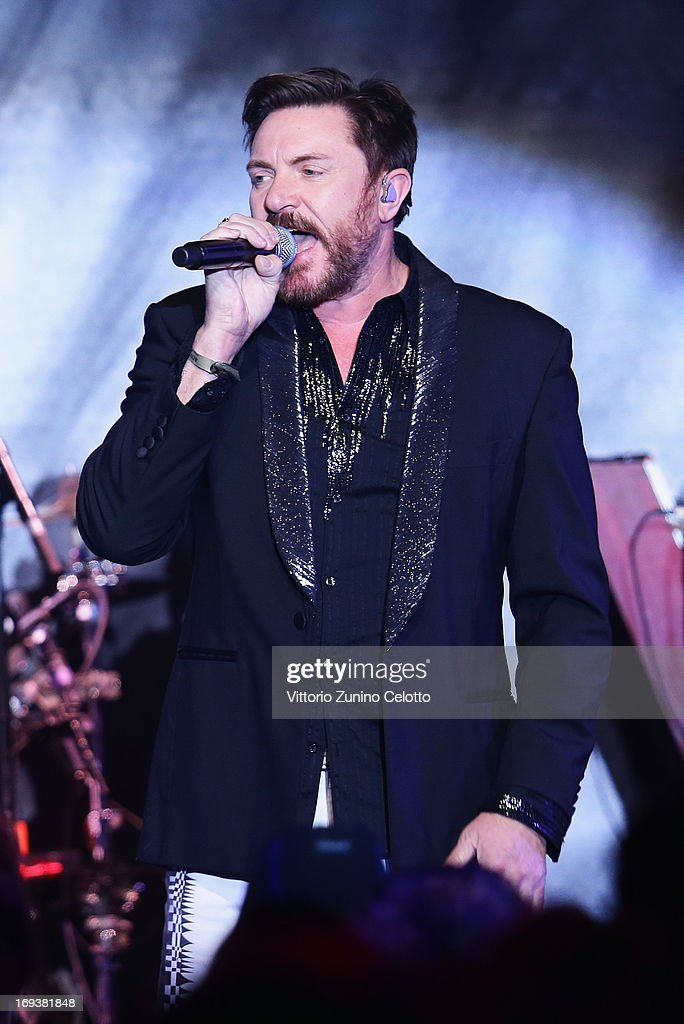 <a gi-track='captionPersonalityLinkClicked' href=/galleries/search?phrase=Simon+Le+Bon&family=editorial&specificpeople=160698 ng-click='$event.stopPropagation()'>Simon Le Bon</a> of Duran Duran perfoms on stage with models at amfAR's 20th Annual Cinema Against AIDS during The 66th Annual Cannes Film Festival at Hotel du Cap-Eden-Roc on May 23, 2013 in Cap d'Antibes, France.
