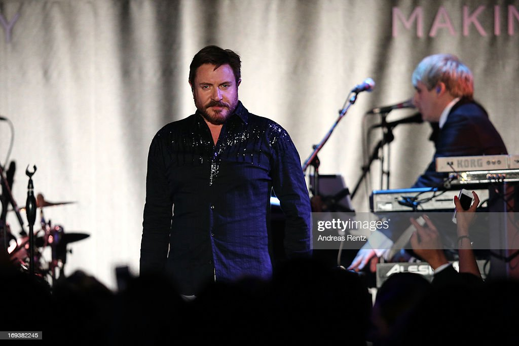 <a gi-track='captionPersonalityLinkClicked' href=/galleries/search?phrase=Simon+Le+Bon&family=editorial&specificpeople=160698 ng-click='$event.stopPropagation()'>Simon Le Bon</a> of Duran Duran performs at amfAR's 20th Annual Cinema Against AIDS during The 66th Annual Cannes Film Festival at Hotel du Cap-Eden-Roc on May 23, 2013 in Cap d'Antibes, France.