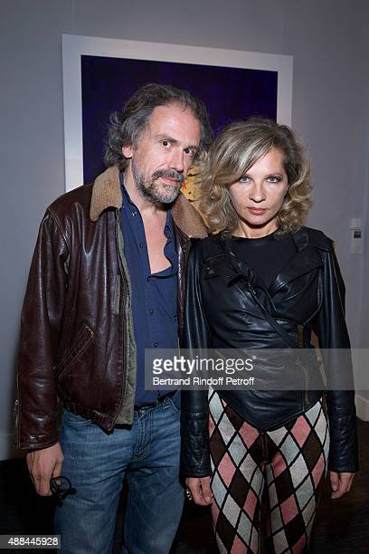 Simon Liberati and Eva Ionesco attend the 'Paintings Poems from Tahar Ben Jelloun Furniture Scriptures from CSaccomanno ODayot' Press Preview at...