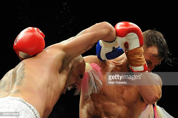Simon Maait punches Nick Atkins during their fight at Total Carnage IV at the Gold Coast Convention and Exhibition Centre on December 14 2013 on the...