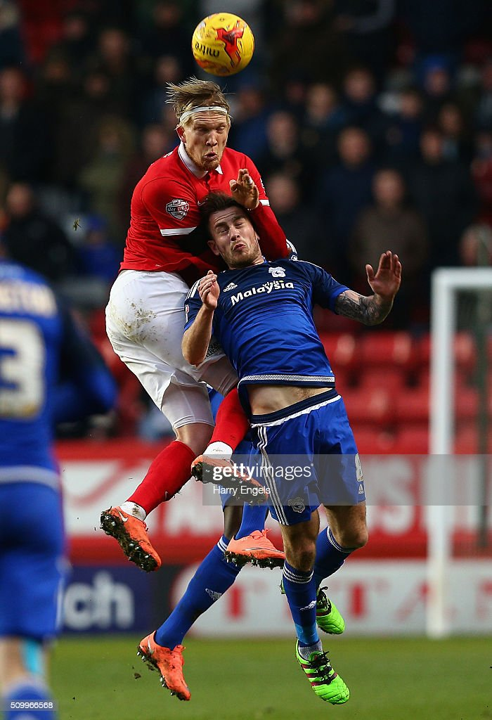 Simon Makienok of Charlton (L) and Joe Ralls of Cardiff compete for a header during the Sky Bet Championship match between Charlton Athletic and Cardiff City at The Valley on February 13, 2016 in London, United Kingdom.