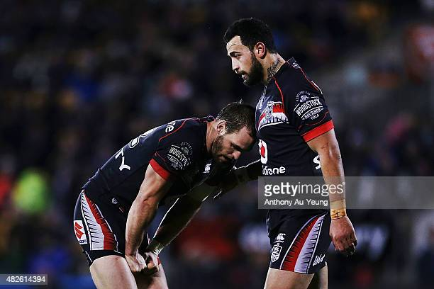 Simon Mannering and Ben Matulino of the Warriors look dejected during the round 21 NRL match between the New Zealand Warriors and the Cronulla Sharks...