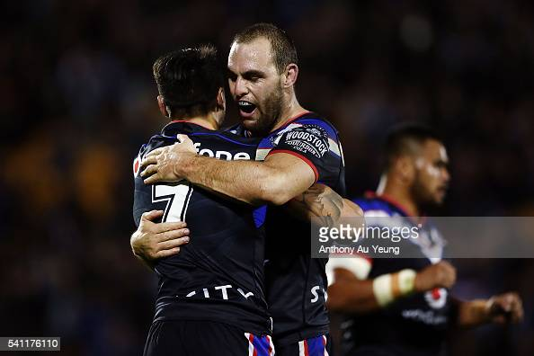Simon Mannering and Shaun Johnson of the Warriors celebrate after winning the round 15 NRL match between the New Zealand Warriors and the Sydney...