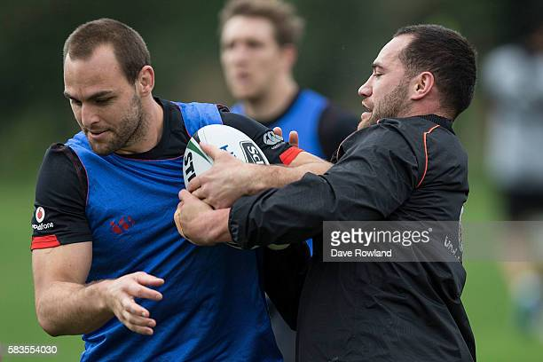 Simon Mannering is tackled by Bodene Thompson during a New Zealand Warriors NRL training session at Mt Smart Stadium on July 27 2016 in Auckland New...
