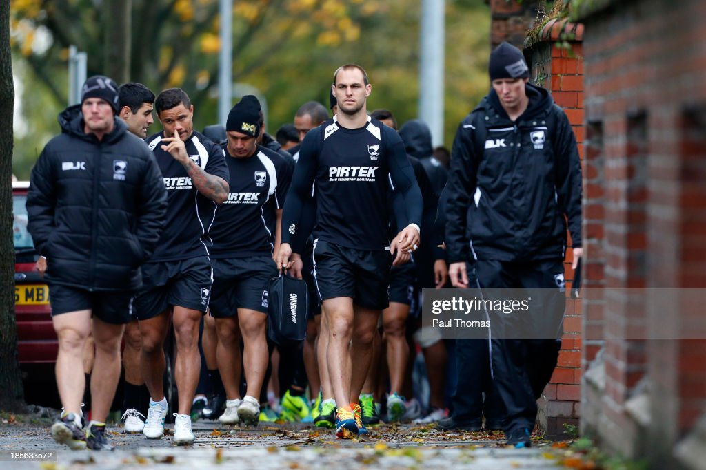 Simon Mannering (C) of New Zealand walks with team mates to the New Zealand training session at St Helens Rugby League Cowley training complex on October 23, 2013 in St Helens, England.