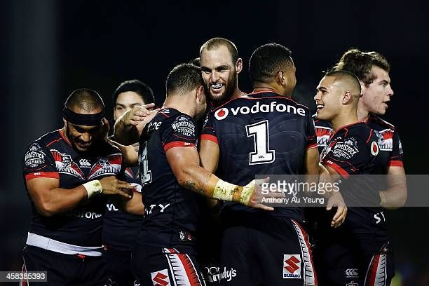 Simon Mannering of the Warriors celebrates with the team on Bodene Thompson's try during the round 17 NRL match between the New Zealand Warriors and...