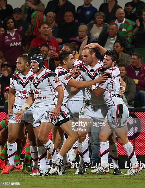 Simon Mannering of the Warriors is congratulated by team mates after crossing for a try during the round 13 NRL match between the South Sydney...