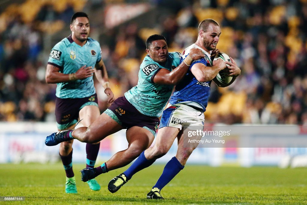 Simon Mannering of the Warriors is tackled by George Fai of the Broncos during the round 12 NRL match between the New Zealand Warriors and the Brisbane Broncos at Mt Smart Stadium on May 27, 2017 in Auckland, New Zealand.