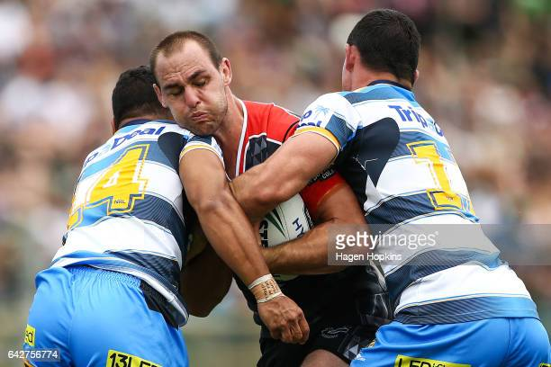 Simon Mannering of the Warriors is tackled by Pat Politoni and Morgan Boyle of the Titans during the NRL Trial match between the Warriors and the...