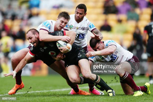 Simon Mannering of the Warriors is tackled by Shaun Lane of the Sea Eagles during the round 25 NRL match between the New Zealand Warriors and the...