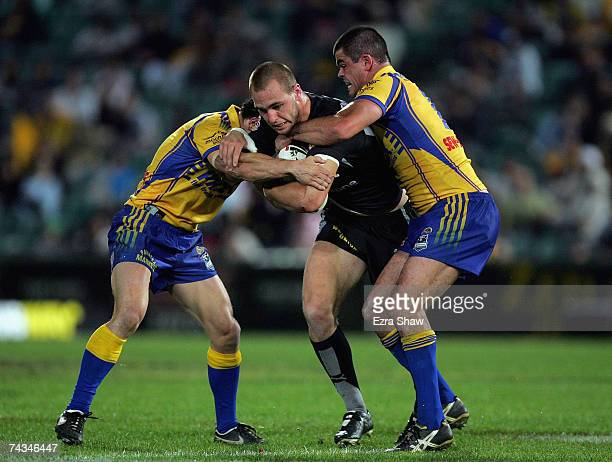 Simon Mannering of the Warriors is tackled by the Eels during the round 11 NRL match between the Parramatta Eels and the Warriors at Parramatta...