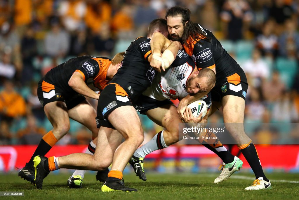 Simon Mannering of the Warriors is tackled during the round 26 NRL match between the Wests Tigers and the New Zealand Warriors at Leichhardt Oval on September 3, 2017 in Sydney, Australia.