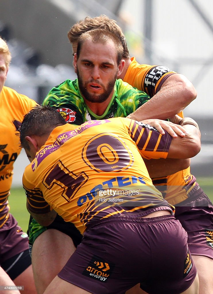 Simon Mannering of the Warriors is wrapped up by the Broncos defence during the NRL trial match between the Brisbane Broncos and the New Zealand Warriors at Forsyth Barr Stadium on February 23, 2014 in Dunedin, New Zealand.
