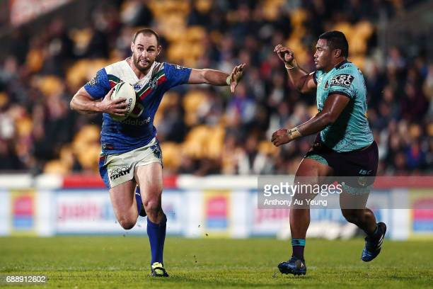 Simon Mannering of the Warriors makes a run against George Fai of the Broncos during the round 12 NRL match between the New Zealand Warriors and the...