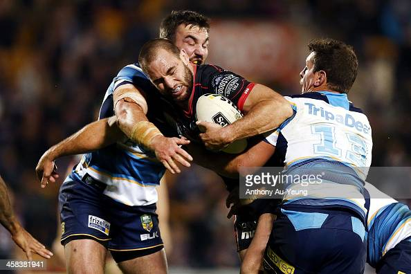 Simon Mannering of the Warriors on the charge against Greg Bird of the Titans during the round 17 NRL match between the New Zealand Warriors and the...