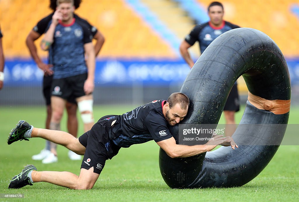Simon Mannering of the Warriors practices tackling on a large inner tube during a New Zealand Warriors NRL training session at Mt Smart Stadium on April 2, 2014 in Auckland, New Zealand.