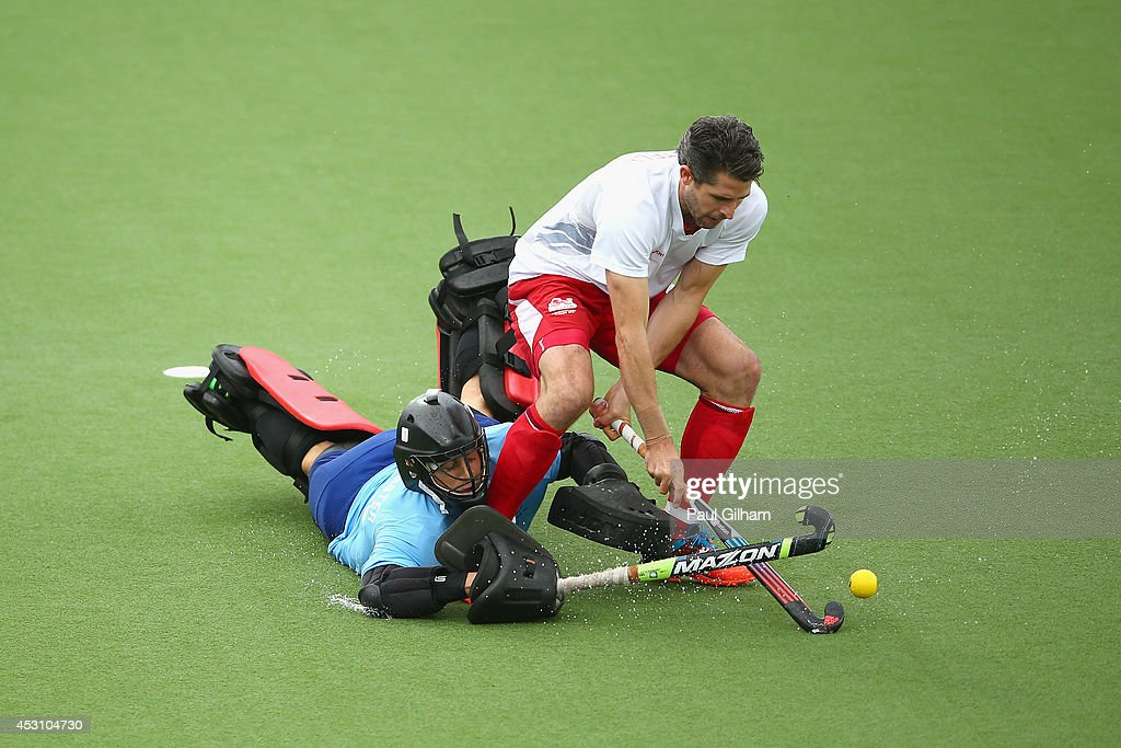Simon Mantell of England takes a penalty against Goalkeeper Devon Manchester of New Zealnd during a penalty shoot out in the bronze medal match between New Zealand and England at Glasgow National Hockey Centre during day eleven of the Glasgow 2014 Commonwealth Games on August 3, 2014 in Glasgow, United Kingdom.