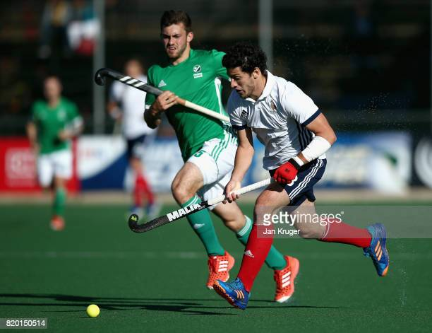 Simon Martin Brisac of France takes the ball past Matthew Bell of Ireland during the 5th8th place play off match between Ireland and France on Day 7...