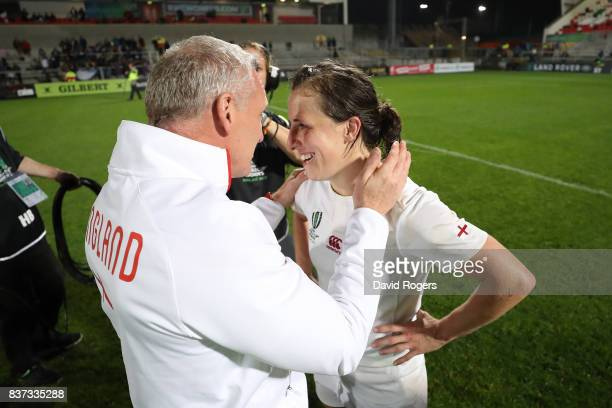 Simon Middleton the head coach of England and Katy Mclean of England celebrate following their team's 203 victory during the Women's Rugby World Cup...