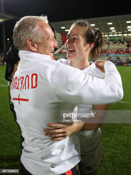 Simon Middleton the head coach of England andEmily Scarratt of England celebrate following their team's 203 victory during the Women's Rugby World...